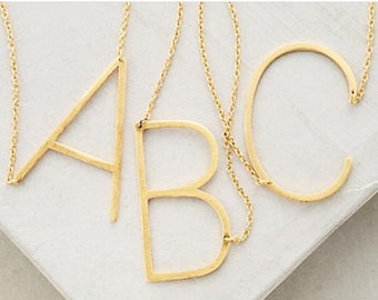 Slanted initial necklace *gold tone