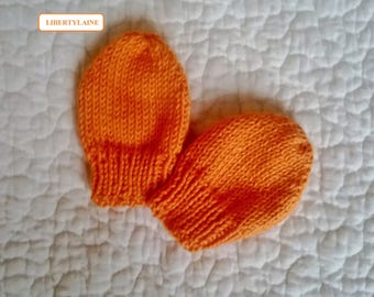 Little mittens handknit size newborn to 1 month orange color.