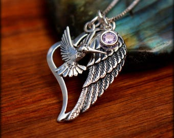 Angel wing necklace. Sterling silver hummingbird and angel wing necklace