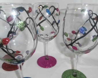 Whimsical glittery light strings ready for your holiday fun. . . Made in the usa.   Set of 4. Hand painted.