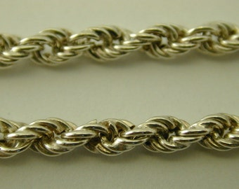 Silver twisted rope chain bracelet. 7 1/2 inches. 3.8 grams