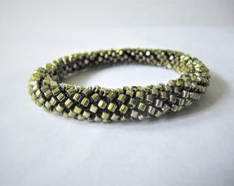 crocheted bracelet from olive-green glass cubes with metallic glimmer