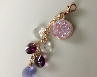 Charm/pendant with Swarovski element and star dust