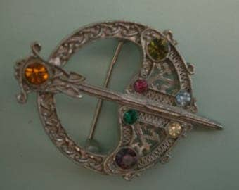 D145) A lovely Vintage silver tone metal and rhinestone Irish Celtic Tara sword Style brooch