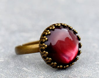 Romantic ring with marsala red stone