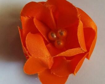 Orange flower barrette