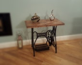 Sewing Machine ConsoleSide Table made from a vintage castiron Jones sewing machine and reclaimed scaffold board wood