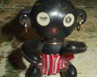 Vintage plastic Black Winky Doll Carnival prize Native 60s