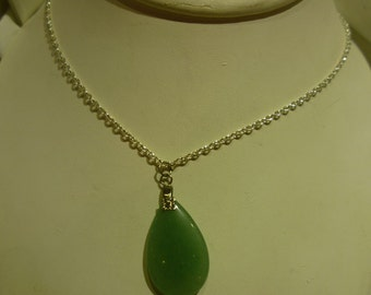 C10 Vintage Jade Pendant on a Thin Silver Toned Necklace.