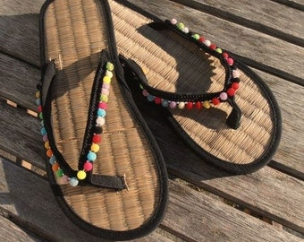 Ladies Straw Flip Flops with Pom Pom trim