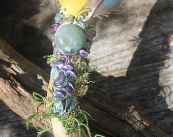 Handcrafted smudge fan with crystals feathers and moss.