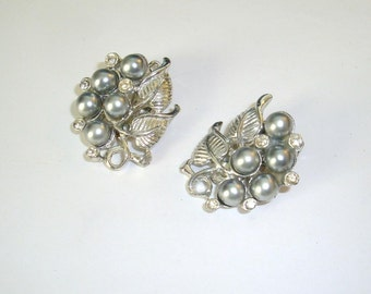 """Vintage clip on earrings Silver tone leaf, faux pearls and rhinestones marked """"P"""". Classic clip-on earrings measure 1 1/8 """" long."""