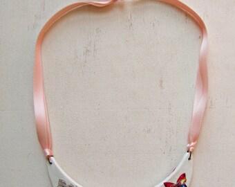 """Flowers"" bib necklace"