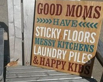Good moms have sticky floors, messy kitchens, laundry piles, and happy kids