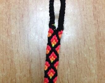 Neon fire colors and black crisscrossed friendship bracelet