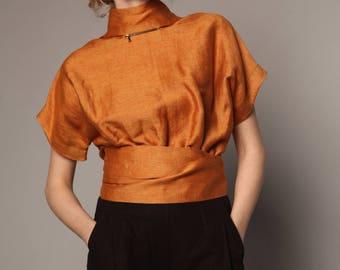 Blouse with zipped drape