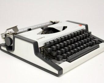 Vintage Olympia Traveller typewriter with case-gray Typewriter