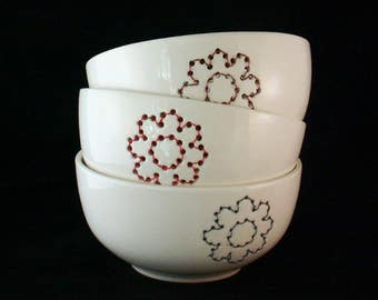 Handmade white ceramic bowl with copper wire embroidered flower