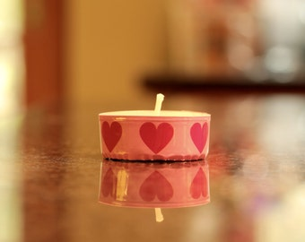 3 tea light candles decorated with pink and red heart pattern