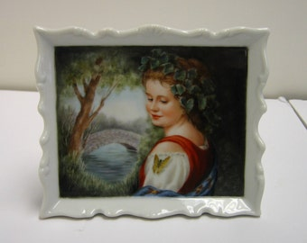 Hand painted portait on porcelain framed plaque