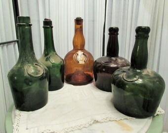 lot of five antique cognac bottles