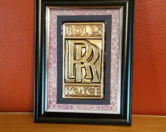 Handmade Embossed Rolls Royce logo made from a recycled soda can.