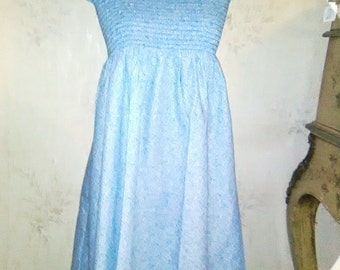 Dress / dress /vintage / smocking dress / straps wide to tie at the shoulders, small ground flowers blue-azure / and on white background.
