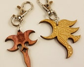 """Yawë (""""elf friend"""") left-facing and Zar'roc (""""misery"""") wood pendant keychain COMBO PACK"""