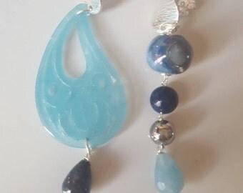 Asimmetrical earrings