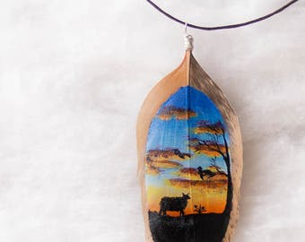 Hand painted cheep and sunset feather jewelry