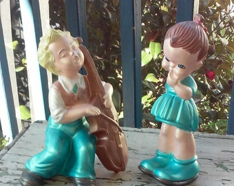 Chalk ware boy and girl