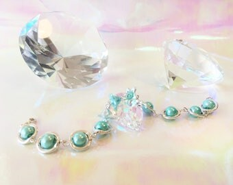 Pearl Bracelet with light turquoise Pearls and Flowers