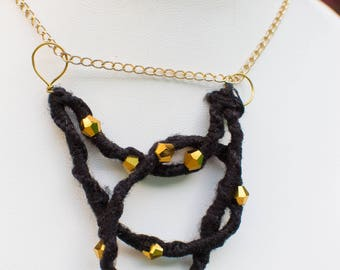 Black wool with Gold plated inlaid beads on gold chain necklace