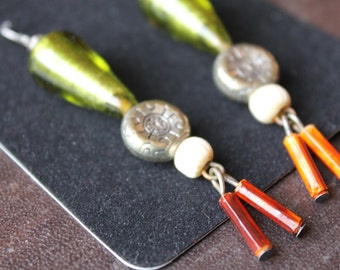 green and brown tribal earrings are global chic.