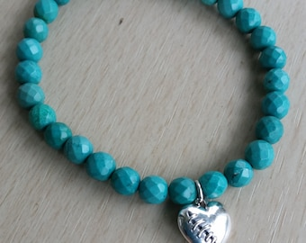Faceted Turquoise glass mala bracelet with a stitched heart