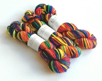 Hand dyed yarn, Super bulky, super chunky. Superwash merino/nylon single ply. Dragon's Flight. Red, black, green, orange, yellow, blue yarn.