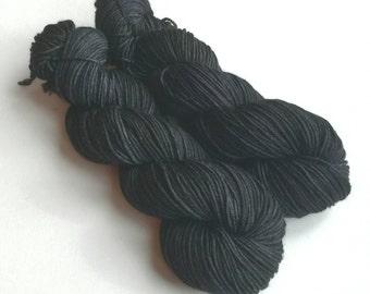 Hand dyed yarn. 100g of sparkle DK yarn. Superwash merino/nylon/stellina. UK dyer. Black sparkly double knit wool yarn. Deep Space yarn.