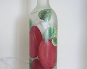 Apples,,, Apples,,,, Apples.... on  a Frosted Lighted Bottle