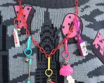 Ultimate 80's Vintage 80's Plastic Bell Clip Toy Charm Necklace Jewelry with Iron, Golf, Toothpaste, Girl, Scotch Liquor Bottle Awesome