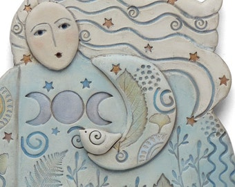 MOONLIGHT MEDITATION, a ceramic sculpture for the wall.