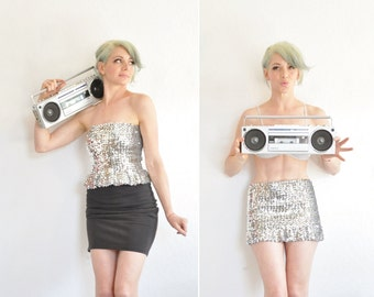 silver sequin tube top or skirt . 2 in 1 ruffle hem . metallic sparkle .extra small.small.xs