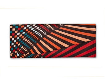 Geometric, tribal print envelope clutch purse with asymmetrical flap. Multicolored clutch purse.
