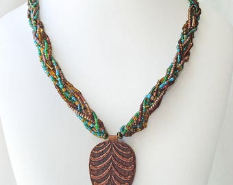 Beaded pendant necklace, multi-strand beaded jewelry, hammered copper leaf pendant, statement boho tribal style necklace