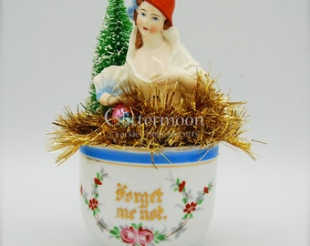 Christmas Scene in Victorian Cup: Forget Me Not - Antique Lady Powder Brush Top - Bottlebrush Tree - Vintage Ornaments