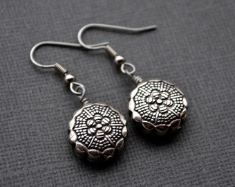 Silver Rounds with Flower Detail . Earrings