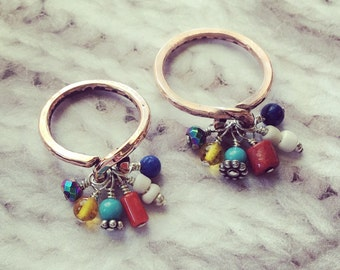 Copper charm rings. Beads include Turquoise, lapis, coral, Amber, Shell and hematite.