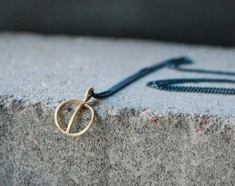 TYYNI Necklace - unique hand formed design, bronze pendant with sterling silver chain