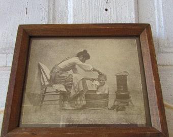 R.Hendrickson framed sepia print woman bathing girl
