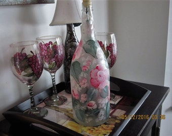 Frosted Wine Bottle with Magenta white hand painted Roses same color wild Flowers green leaves and white Baby breath