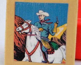 Tile magnet with cowboy design